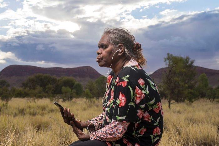 Rene Kulitja listening to meditations that she helped to create.
